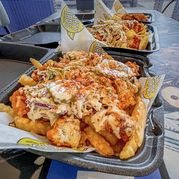Hot chicken on top of fries served at our Nashville style hot chicken restaurant in South Gate, CA.
