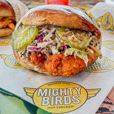 Chicken sandwich with pickles and coleslaw for lunch near Southern Ave in South Gate CA served by Mighty Birds.